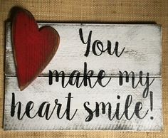 """⊹⊱● You make my heart smile! With attached distressed wood heart. Wood Sign ●⊰⊹ Decorate your home with this handmade, distressed Western Red Cedar All of Me Loves All of You Wood Sign. This rustic hand-painted sign will be a beautiful addition to your decor! Great for Valentines day decor, year round or for a wedding or anniversary. ✈ Ready to Ship! ★ Sign Features ˚Colors: White background, black text & graphic with red heart. ˚Measurements: 11 tall x 16"""" wide. (Measurements may vary ..."""