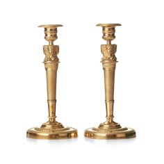 A PAIR OF FRENCH EMPIRE EARLY 19TH CENTURY GILT BRONZE CANDLESTICKS. Height 27cm.