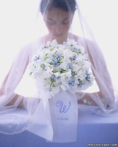 A perfumed burst of about 80 sweet peas, an old-fashioned favorite for early-summer brides, is dotted by something blue, tweedia, and bound by a ribbon embroidered with the bride and groom's initial and wedding date. this is from 1998 and its still current