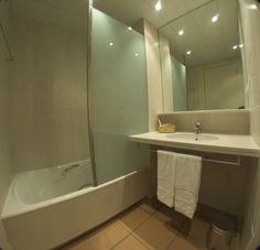 Bathroom with bath, apartments persons. Bathroom Lighting, Bathtub, Mirror, Furniture, Home Decor, Bathroom Light Fittings, Standing Bath, Homemade Home Decor