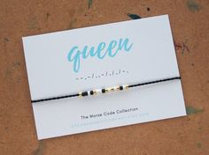 The perfect gift for the queen in your life (even if its yourself)! Morse code bracelets are a fun way to carry a special word, name, or message with you wherever you go. --Shipped on a cardstock presentation card, perfect for giving as a gift! --Made with 100% cotton, hand-twisted thread and high quality Japanese glass beads. --Approximately twelves inches long, allowing it to be worn as a bracelet or an anklet, and features a beaded slide closure, making it fully adjustable. To shorten…