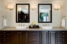 Mosaic Tile Vanity Backsplash | Custom-made mirrors match the vanity and are harmoniously balanced by ...