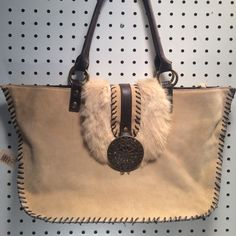 Suede and Fur boho purse Suede and Fur Bag with leather stitching. A few scuff marks but in good condition. Nicole Lee Bags Shoulder Bags
