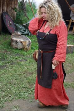 Viking reenactress, Wolin. That object in her left hand looks like a salt container, made from bone, though it could be a needle case as well, both looked very similar. https://www.flickr.com/photos/elamichalec/sets/72157624565884953