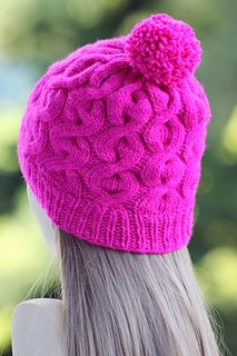 "This cute cabled hat is made with roughly 175 yards of worsted/aran weight yarn and 2 16"" circular needles - one in size US 8, one in size US 9, as well as a set of double pointed needles, also in size US 9."