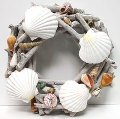 Driftwood Shell Wreath - Seashell Decor (http://www.caseashells.com/driftwood-shell-wreath/)