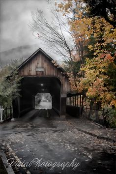 "The middle bridge or the Woodstock Vermont covered bridge is of course located in Woodstock Vermont. Not to be confused with Woodstock NH which doesn't have a covered bridge. I don't know where or why I thought Lonely Wind when I was working the image. But I think it was the fog and low clouds that made me think of it. I remembered that in a John Wayne movie the name Tahnee Mara came up. ""Tahnimara the Comanches call it, Lonely wind..."""