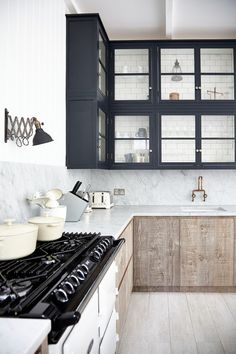 Scandinavian Kitchen  Preferred color and texture combination. Can incorporate black framed windows as an alternative to an open kitchen concept, to make the area look more spacious