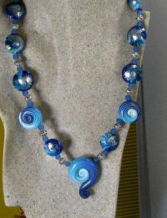 Blue and Silver Polymer Clay Bead Necklace Sassy and unusual necklace. Big impacted Bright sassy colors http://www.vpsjewelry.com/blue-and-silver-polymer-clay-bead-necklace.html