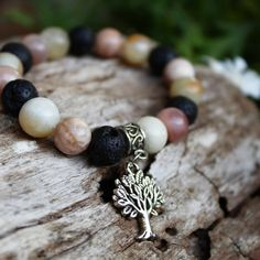 Sunstone diffuser bracelet with tree of life charm. . . . . . . . . Follow @pagan_moon_store . . . . #sunstone #crystals #crystaljunkie… Moon Store, Crystal Shop, Crystal Bracelets, Tree Of Life, Bracelet Designs, Pagan, Diffuser, Victoria, Charmed