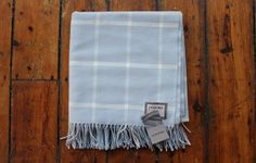 Pale blue and white check blanket from Foxford. This blanket in pale blue and white windowpane pattern is made with pure new lambswool and rolled Home Accessories Uk, White Throws, Blue Blanket, Grey And White, Aqua, Pure Products, House Styles, Country