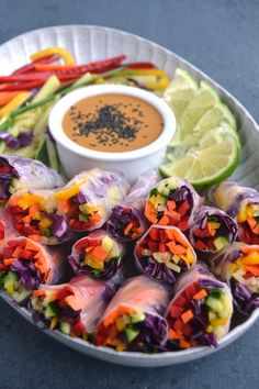 Rainbow Veggie Spring Rolls with Peanut Dipping Sauce are loaded with red pepper, carrots, yellow peppers, cucumber, green onion and red cabbage and dipped in an easy peanut sauce for the perfect appetizer. Spring Roll Peanut Sauce, Easy Peanut Sauce, Peanut Dipping Sauces, Healthy Appetizers, Appetizers For Party, Appetizer Recipes, Italian Appetizers, Recipes Dinner, Food Blogs