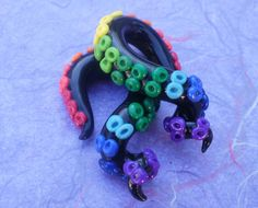 Dark Rainbow Tentacle Gauged earring. $30.00, via Etsy.