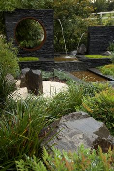 Beautiful landscape idea. Something is happening everywhere! Love the water feature with the hole in it so you can see some more garden.