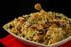 Hyderabadi Chicken Biryani Recipe Main Dishes with chicken, garlic, ginger, salt, lemon, yoghurt, turmeric, red chile powder, garam masala, coriander, mint, green chilies, onions, ghee, rice, almonds, bay leaf, clove, cardamom, cumin seed, cinnamon, saffron, water