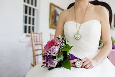 Add a watch to the bouquet. The long chunky necklace is beautiful.