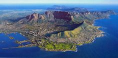 Table Mountain is the famous landmark that towers over Cape Town, South Africa. There are some great views of the city from the top (accessible via hiking trail and cableway). Table Mountain Cape Town, Top 10 Destinations, Wedding Destinations, Cape Town Hotels, Le Cap, Cape Town South Africa, Pretoria, Most Beautiful Cities, Africa Travel