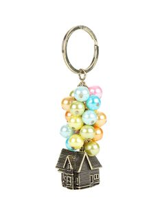 "<p>Gold tone key chain from Disney-Pixar's Up with an awesome house & balloons design pendant.</p> <ul> <li>Approx. 3"" long </li> <li>Metal </li> <li>Imported </li> </ul>"
