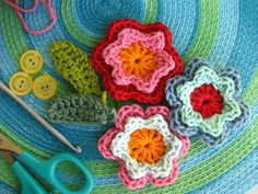 making a handful of these cute flowers to help embellish the baby blanket I'm working on...I'm so glad I taught myself how to crochet!