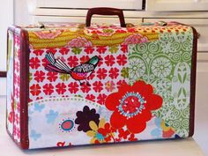 Suitcase covered in fabric scraps. Super cute!