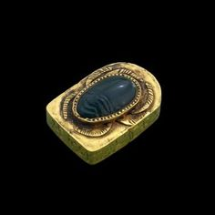 The first heart scarab found intact, tomb of King Sobhekemsaf, Thebes, Egypt. Scarab with head of a man mounted in gold; ca. 1590 B.C. 3.8 cm. long x 2.5 cm. wide. The purpose of such a scarab was to protect the heart for the afterlife.