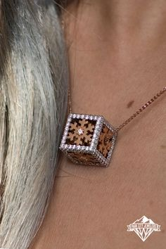 Uniquely designed and expertly hand crafted by the immensely talented designers at Park City Jewelers, this snowflake cube pendant is breathtaking and awe-inspiring. The soft femininity of each rose gold snowflake is accented by the brilliance of a single round diamond at the center of the snowflake. Demi-pavé set diamonds form the crisp and brightly shimmering angles of this unique snowflake cube. Snowflake Jewelry, Bentley Mulsanne, Park City, Femininity, Types Of Metal, Round Diamonds, Angles, Snowflakes