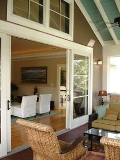 I love the idea of big sliding doors opening to a screened porch by kerry