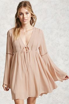 Forever 21 Contemporary - A woven crinkled dress featuring a plunging neckline, long bell sleeves, ladder cutout, tie-front, and a flare hem. Dress Outfits, Casual Dresses, Short Dresses, Hijab Dress, Dress Long, Plunging Neckline Dress, Simple Gowns, Pakistani Bridal Wear, Bell Sleeve Dress
