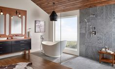 This gorgeous bathroom combines rich tropical wood with different textures of grey stone to create a warm, soothing ambiance. The shower floor and backsplash is lined with Ostrich Grey Quartzite tiles from India which are durable, water-resistant and easy-to-clean, making this shower hassle-free as well as rejuvenating.Image via MSI
