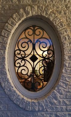 Budget Blinds is not just for beautiful blinds.   Did you know we offer amazing accents like faux-iron?   Here is an example of a gorgeous window grill on this oval 'Captain's Window'.  This elegant accent piece is bound to impress and is an affordable alternative to custom iron.
