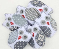 Three grey and white owl ornaments, handmade from felt and cotton prints with hand embroidered details. Grey and white Scandi colors. Each owl is 8cm high and has a cotton loop for hanging. The listin