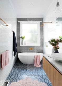 Narrow bathroom, love the overall idea with the tiles, timber window and seperate bath and shower.