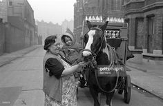 A Southwark woman on her milk round near the Elephant and Castle in South London. Original Publication: Picture Post - 4694 - Life At The Elephant - pub. 1949