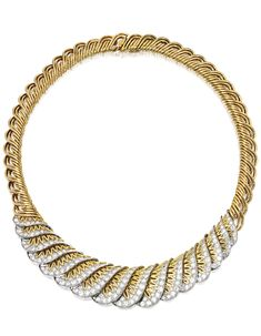 18 KARAT GOLD, PLATINUM AND DIAMOND NECKLACE, CARTIER, PARIS, CIRCA 1950. Of openwork design with scalloped edges, set with numerous round diamonds weighing approximately 8.30 carats, gross weight approximately 71 dwts, length 15½ inches, signed Cartier Paris, France, partial French workshop marks and French export mark.