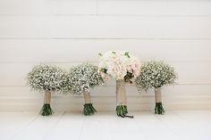 bridesmaids carry babys breath bouquet