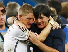 Final World Cup 2014 Brazil -  Germany's Bastian Schweinsteiger (L) embraces coach Joachim Loew as they celebrate their win against Argentina after their 2014 World Cup final at the Maracana stadium in Rio de Janeiro July 13, 2014