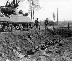 Sherman tank on the road to Berlin and dead German soldiers. The fall of the Nazi Regime.