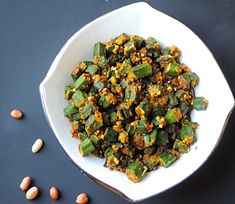 Bhindi aka Okra aka Lady finger has been my favorite vegetable since childhood. I loved Bhindi so much that I can even eat it raw. I love to cook it in different styles and with different recipes. Usually I cook bhindi with lots of onions, … Peanut Recipes, Curry Recipes, Peanut Masala, Bhindi Masala Recipe, Healthy Cooking, Cooking Recipes, Healthy Indian Recipes, South Indian Food, Indian Foods