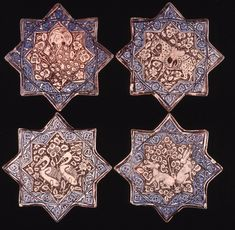 Group of eight-pointed star tiles.Fritware (stonepaste), painted in blue and lustre over an opaque white glaze. Asia, Iran,Central Iran, I...