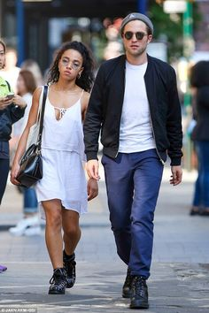 So in love: Robert Pattinson and fiancee FKA twigs took a stroll in New York on Tuesday...