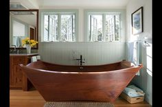 Wooden...yep wooden bathtubs.  Made by two former Vermonters who knew that wood kept water out of boats, so why not keep it in?