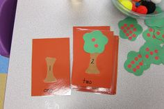 Match the tree top with the correct number of apples to the trunk with corresponding number