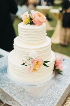 Pretty floral topped white wedding cake: http://www.stylemepretty.com/south-carolina-weddings/edisto/2016/01/11/elegant-timeless-waterside-southern-wedding/ | Photography: Caroline Ro - http://carolinero.com/