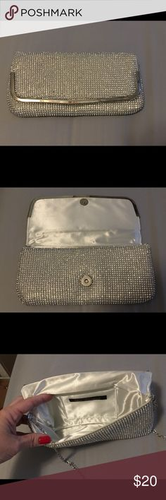 Silver (Metallic) evening clutch Used only once, for Prom.  Excellent condition.  Can be used as a clutch, or has a silver strap for your shoulder. Purchased for $40.00, selling for $20.00. Lulu Townsend Bags Clutches & Wristlets
