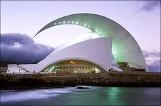 Tenerife Concert Hall in Santa Cruz, Canary Islands, Spain; designed by Santiago Calatrava;Rising up like a wave, the roof soars to a height of 190 feet over the main auditorium before curving downward to a point. Santiago Calatrava, Unique Buildings, Interesting Buildings, Amazing Buildings, Office Buildings, Art Et Architecture, Futuristic Architecture, Beautiful Architecture, Chinese Architecture