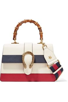 First seen on the Fall '16 runway, Gucci's shoulder bag effortlessly combines its heritage and contemporary codes - it has the house's iconic bamboo handle and cult 'Dionysus' clasp. This red, white and navy leather piece has three ideally sized compartments for your everyday essentials and a detachable striped strap - a subtle nod to the brand's equestrian roots.