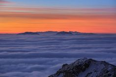"""""""Winter Sunrise"""" - photo by Cedar K., via National Geographic;  """"Four climbers standing at the summit of a snowy mountain, watching sunrise above the endless sea of clouds."""";  Sichuan Province, China"""