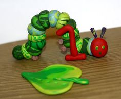 Items similar to The Very Hungry Caterpillar with Large Green Leaf - Clay Birthday Cake Topper on Etsy Polymer Clay Cake, Hungry Caterpillar Party, Fondant Toppers, 1st Birthday Parties, Birthday Ideas, Sugar Art, Birthday Cake Toppers, Projects To Try, Class Projects