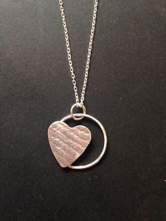 Sterling silver floating heart. Silver by Kat.