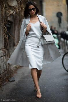 stunning. - Reminds me of a dress I saw Carrie wear in SATC - grey Silver silky dress #Milan #streetstyle